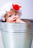 Baby on a bucket Stock Photo