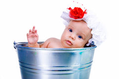 Baby on a bucket Royalty Free Stock Photography