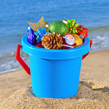 Baby bucket with gifts and Christmas decorations Royalty Free Stock Images