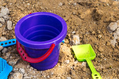 Baby bucket and shovel in the sandbox Stock Photo