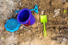 Baby bucket and shovel in the sandbox Stock Images