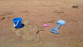 Baby bucket and shovel on the shore. Baby bucket and shovel on the sandy seashore. active sea holiday with children stock video footage