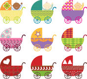 Baby Buggy. Retro baby buggies in different colors Royalty Free Stock Images