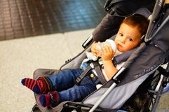 Baby in buggy Royalty Free Stock Photography