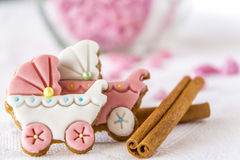 Baby buggy cookies for princesses with cinnamon. Baby buggy ginger cookies with fondant and cinnamon. White background with pink decorations Stock Image