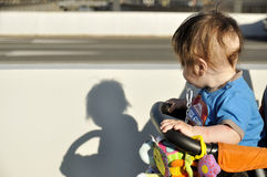 Baby in buggy look on shadow. In daylight Stock Photos