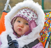 Baby in a buggy with safety straps. Royalty Free Stock Photo