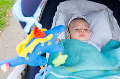 Baby in buggy Stock Photo