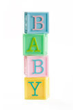 Baby building blocks. Tower of building blocks spelling baby Stock Photos