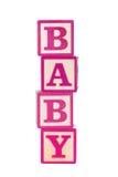 Baby building blocks. Pink wooden baby building blocks stock images