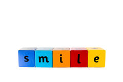 Baby building blocks Smile. The word Smile made with colourful baby's building blocks royalty free stock image