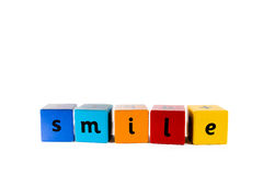 Baby building blocks Smile. The word Smile made with colourful baby's building blocks stock images