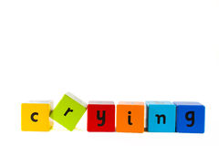 Baby building blocks spelling 'Crying'. The word Crying made with colourful baby's building blocks stock photo