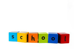 Baby building blocks spelling 'School'. The word School made with colourful baby's building blocks stock photography
