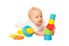 Baby building tower of colorful blocks. Royalty Free Stock Photography
