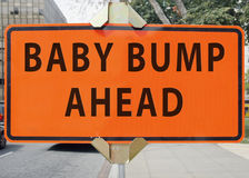 BABY BUMP AHEAD road sign. Humorous BABY BUMP AHEAD pregnancy road sign Royalty Free Stock Photography