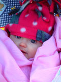 Baby bundled up. Portrait of baby bundled up in winter clothing to stay warm Royalty Free Stock Images