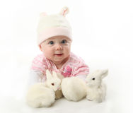 Baby and bunnies Stock Image