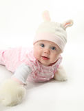 Baby bunny. Portrait of an adorable baby girl wearing a bunny rabbit costume and furry mittens Royalty Free Stock Photo
