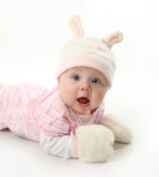 Baby bunny. Portrait of an adorable baby girl wearing a bunny rabbit costume Stock Image