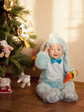 Baby in bunny costume Stock Images