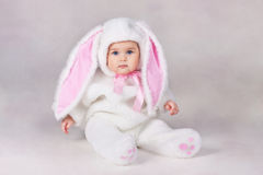 Baby in bunny costume. Small child in a white bunny costume stock photos