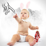 Baby with Bunny Ears and candy. Funny pictures Stock Images