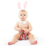 Baby with Bunny Ears. And Christmas decorations Stock Photo