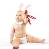 Baby with Bunny Ears. And Christmas decorations Royalty Free Stock Image
