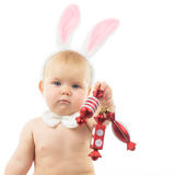 Baby with Bunny Ears. And Christmas decorations Stock Image
