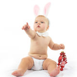 Baby with Bunny Ears. And Christmas decorations Royalty Free Stock Photos