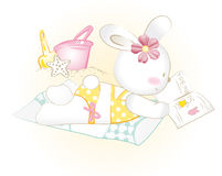Baby bunny girl to sunbathe Stock Photography
