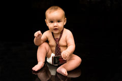 Baby businessman holding cell phone Stock Photo