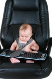 Baby businessman looks at keyboard