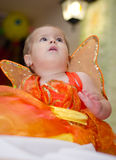 Baby butterfly. Baby girl dressed as a butterfly on Halloween stock photo