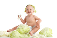 Baby with cabbage Stock Images