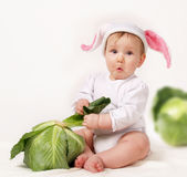 Baby with cabbage stock photos