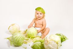 Baby with cabbage Royalty Free Stock Photo