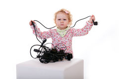 Baby with cable tangle spaghetti Stock Photos