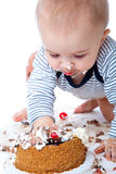 Baby and cake. Isolated on white background stock photos