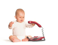 Baby calls on phone Stock Images