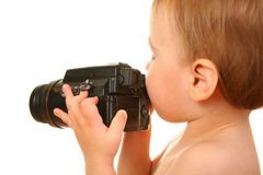 Baby with camera Stock Photos
