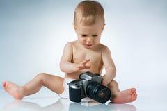 Baby with camera Stock Photo