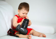 Baby with camera Royalty Free Stock Images