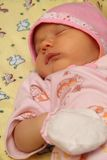 Baby in cap. Sleeps on the diaper Royalty Free Stock Photos