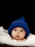 Baby with cap. Studio portrait baby on isolated black background Stock Photography