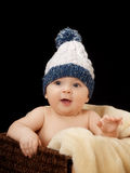 Baby with cap. Studio portrait baby on isolated black background Royalty Free Stock Photos