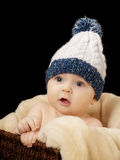 Baby with cap. Studio portrait baby on isolated black background Stock Photos