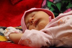 Baby in cap sleeps Royalty Free Stock Image