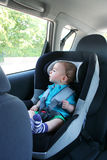 Baby in car. Seat for safety, looking outside Stock Photography